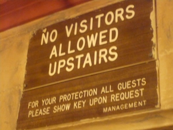 "10. ""No visitors allowed upstairs"" sign"