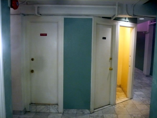 11. Bathrooms in the 11th floor hallway at Hotel Cecil