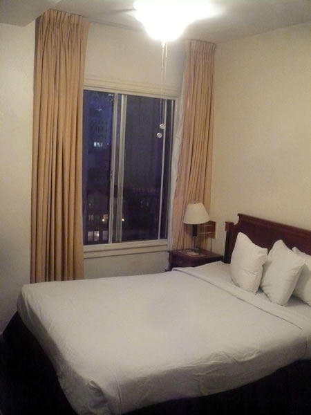 17. The bed and window in my room at Hotel Cecil