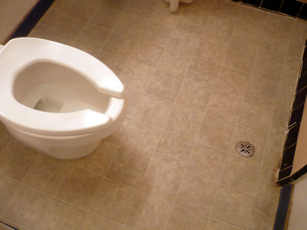 22. Toilet and floor drain in my in-room bathroom at Hotel Cecil