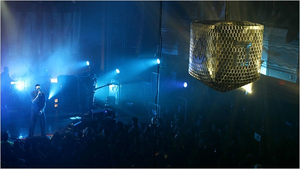 Mastiyahu onstage with a dreidel disco ball in the foreground