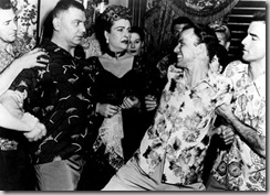 "Breaking up the brawl between Ernest Borgnine and Frank Sinatra in ""From Here to Eternity"", bith men wearing aloha shirts"