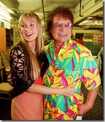 Don Ho, in an aloha shirt, with his daughter Hoku