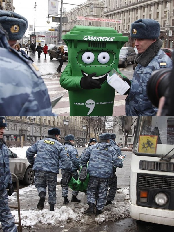 Greenpeace activist dressed as recycling can taken off to be recycled by Eastern European police
