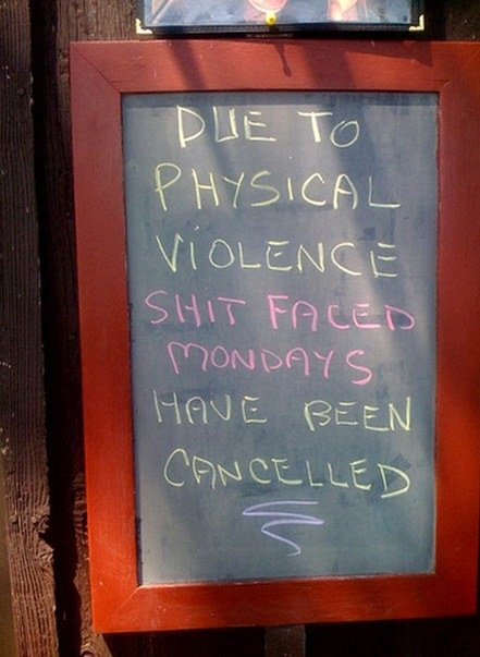 "Chalkboard sign outside a bar: ""Due to physical violance, Shit Faced Mondays have been cancelled."""
