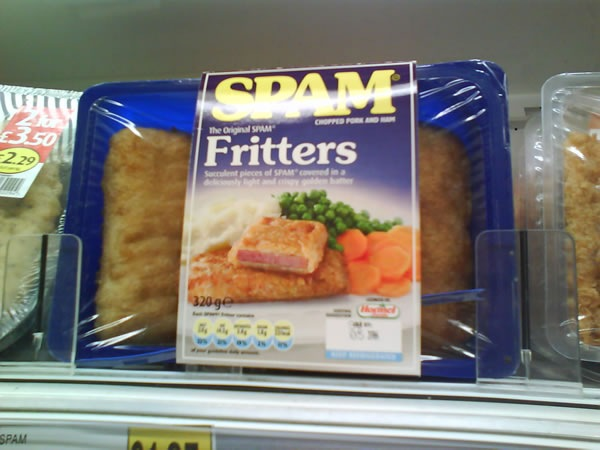 Package of Spam Fritters on a refrigerated grocery shelf.