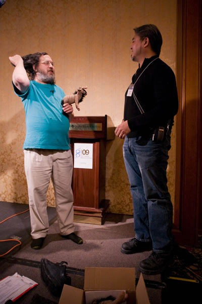 Richard Stallman and Joey deVilla onstage with a plush gnu at the CUSEC 2009 conference