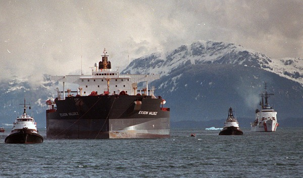 The Exxon Valdez being escorted by Coast Guard ships