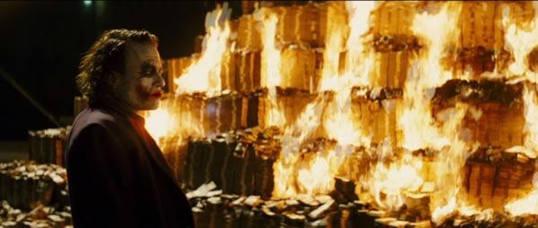 "Still from ""The Dark Knight"" fetauring the Joker burning a giant pile of money"