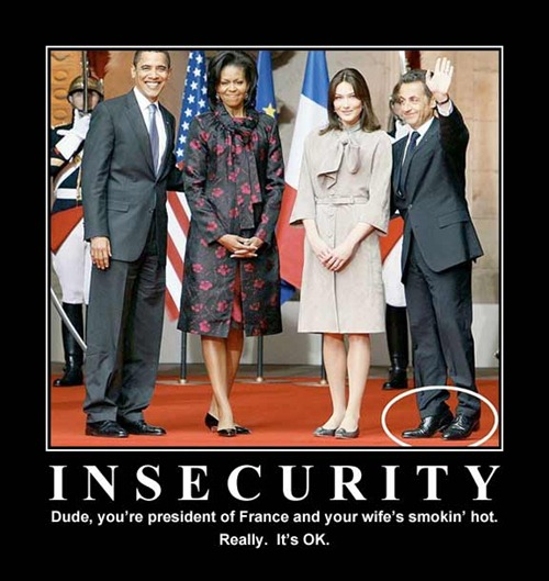 """""""Motivational"""" poster featuring Nicolas Sarkozy standing on his toes beside his taller wife, Carla Bruni. """"Insecurity: Dude, you're the president of France and your wife's smokin' hot. Really. It's OK."""""""