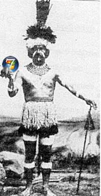 Shaman holding a Windows 7 logo