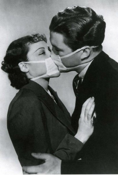 Man and woman in surgical masks, kissing