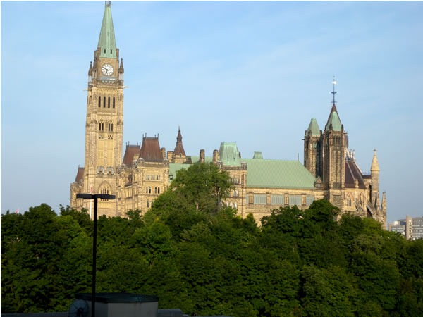 Parliament buildings in Ottawa, with tress in the foreground
