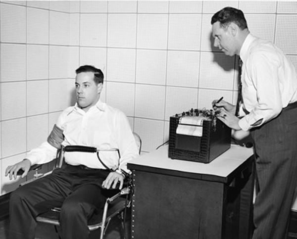 Black and white photo of a late 50s/early 60s-era polygraph exam