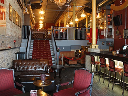 View of lower room and staircase at Pravda Vodka Bar