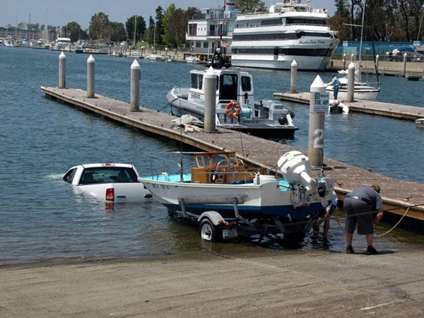 Truck with boat trailer lower boat into the water...truck first.
