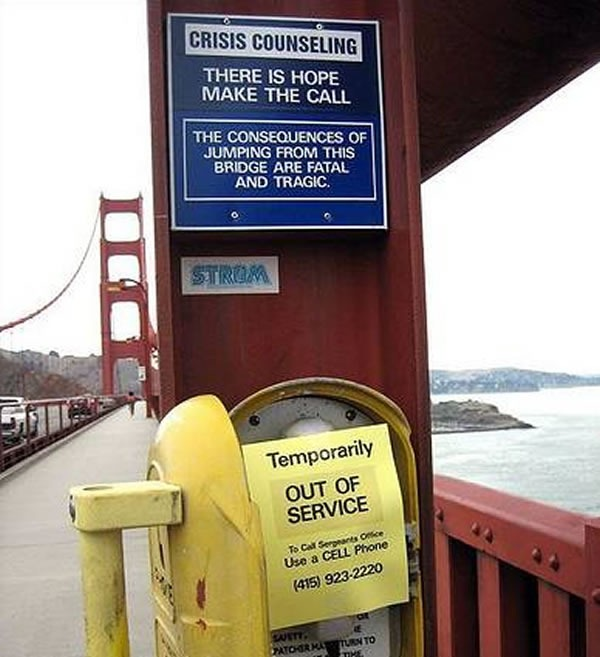 "Sign on Golden Gate Bridge: ""Crisis Counseling / There is hope, make the call / The consequences of jumping from this bridge are fata and tragic"". Below it is the help phone with a piece of paper taped over it: ""Temporarily out of service / To call sergeant's office use a cell phone / (415) 923-2220"""
