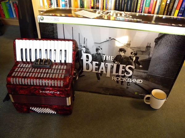 "Photo: My little red accordion, dwarfed by the box for the deluxe edition of ""The Beatles: Rock Band"""