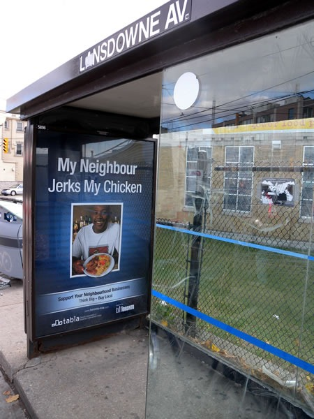 "Bus shelter featuring the ad ""My Neighbour Jerks My Chicken"""