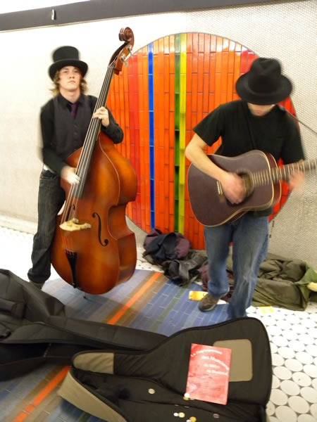 Upright bass player and guitar player in Montreal Metro