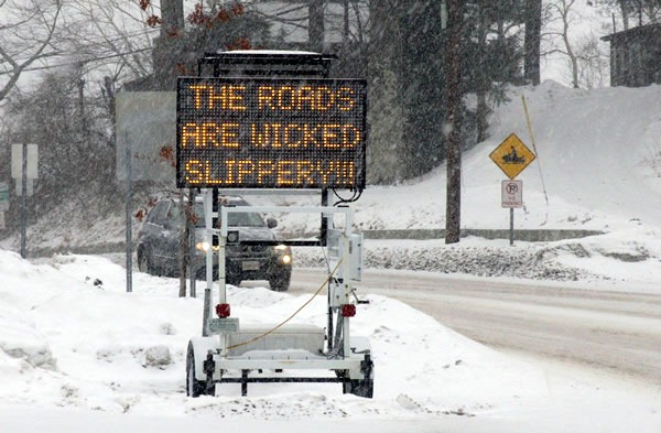 Winter road with pixel highway sign that reads 'The roads are wicked slippery!!!'