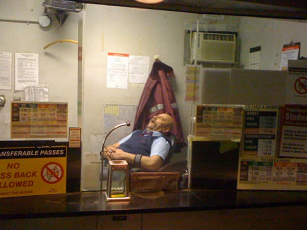 TTC collector's booth, with a TTC collector sleeping in his chair