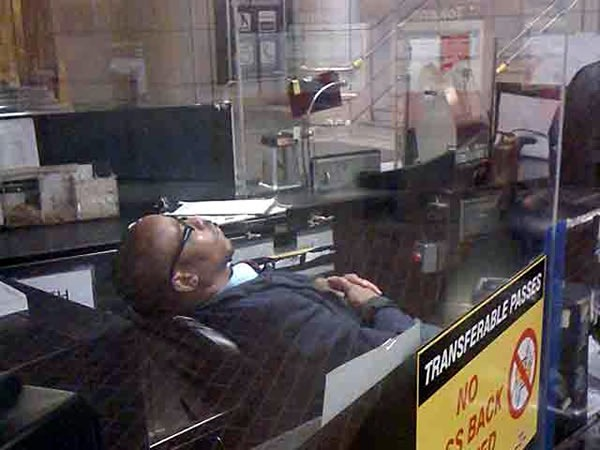 Another TTC collector's booth, with another TTC collector sleeping in his chair