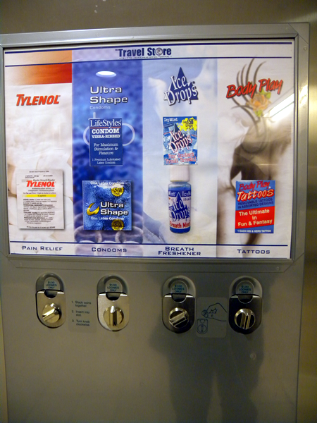 """Travel store"" vending machine featuring: Tylenol, condoms, Ice Drops breath mints and Body Play tattoos."