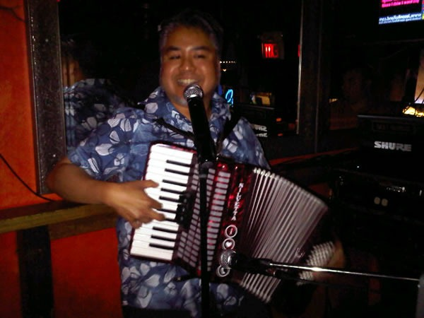 "Joey deVilla playing ""Ain't No Rest for the Wicked"" on accordion at Loser Karaoke"