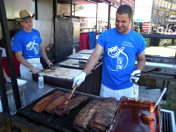 Ribbers preparing ribs on the grill at Kentucky Smokehouse