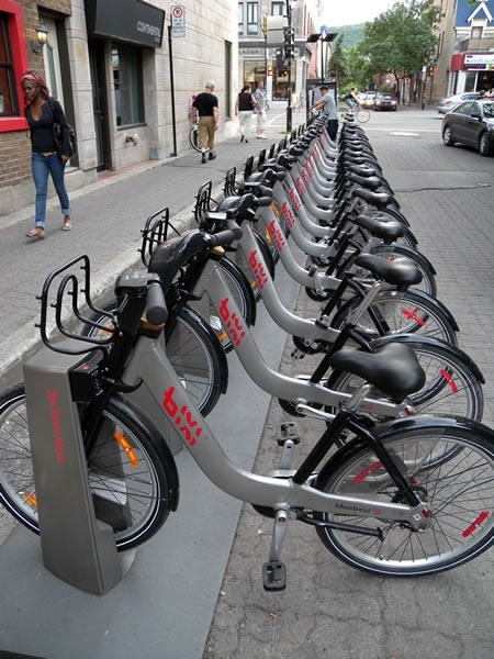 Row of Montreal Bixi bikes in their docking station