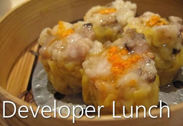 """Developer Lunch"": Photo of bamboo steamer containing 4 siu mai"