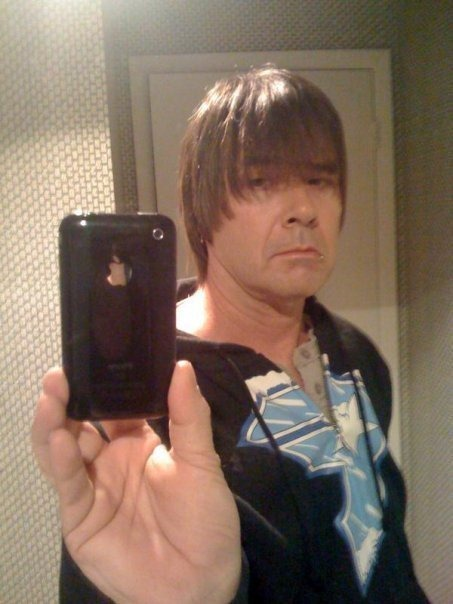 Emo Dad taking a mirror self-portrait with his iPhone