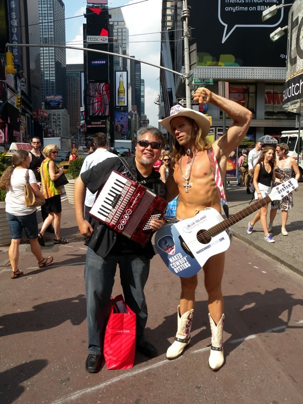 Joey deVilla with his accordion and the Naked Cowboy at New York's Times Square, July 2010