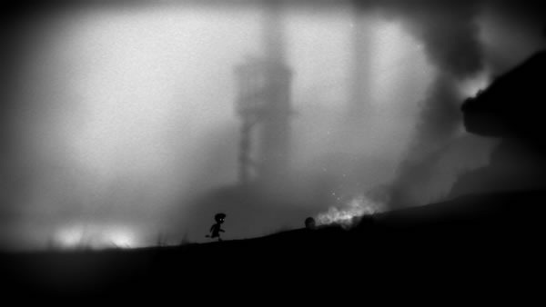 Limbo screenshot: the boys runs towards some rolling flaming logs