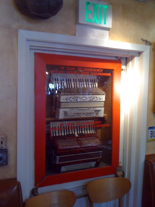 """Two accordions in an """"In case of emergency, break glass"""" case"""