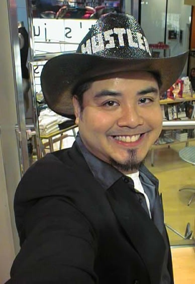 "Joey deVilla in a cowboy hat with the word ""Hustler"" spelled in glitter"
