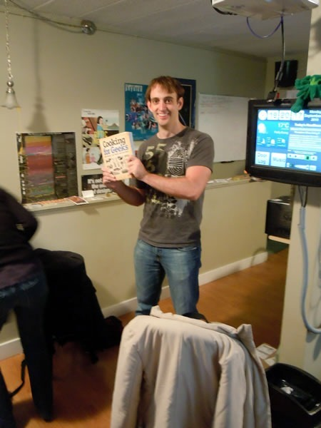 Jeff Potter poses with his book, Cooking for Geeks, at HacklabTO
