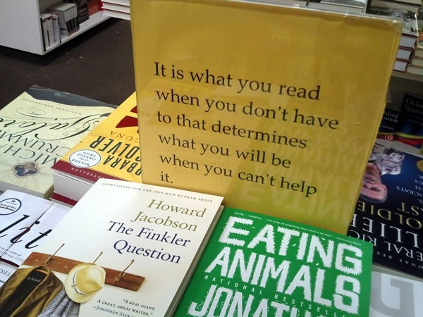"Sign on table of books: ""It is what you read when you don't have to that determines what you will be when you can't help it"""