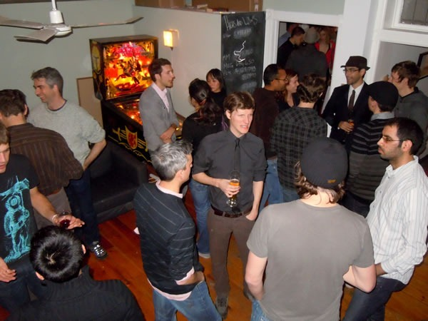 """Unspace's """"pinball room"""", filled with nerdy partygoers."""
