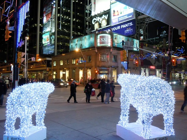 Corner of Yonge and Dundas, looking northwest between two polar bears made of lights