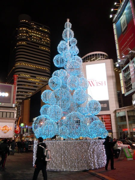 A Christmas tree made of lights at Dundas Square