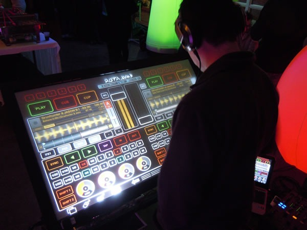 DJ using a massive touchscreen