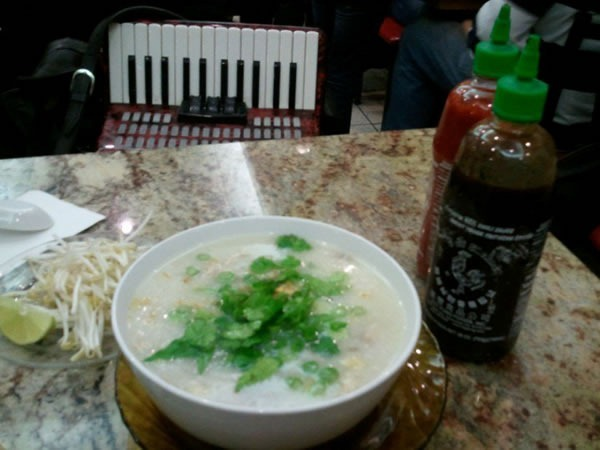 Bowl of congee, with the accordion in the background
