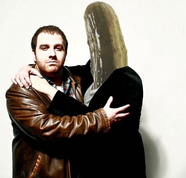 Guy Gal hugging a person with a pickle for a head