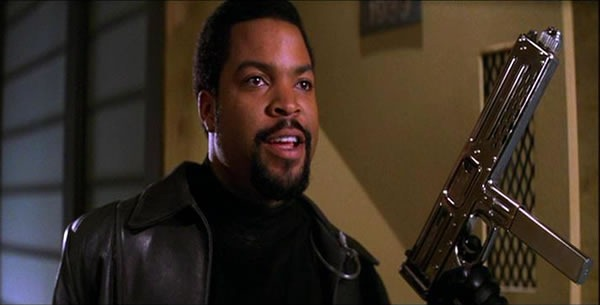 "Ice Cube in the movie ""Trespass"", wearing a black turtleneck, a black leather jacket and holding a silver MAC-10. Damn!"
