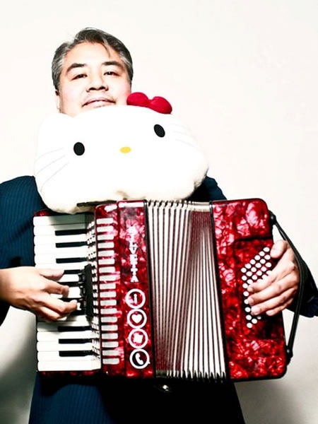 "Joey deVilla and his read accordion with a big ""Hello Kitty"" head"
