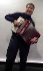 Joey deVilla playing accordion