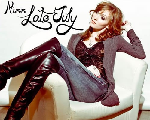 """""""Miss Late July"""": Nicole Simone lying down in an easy chair"""
