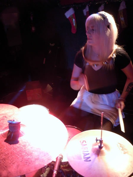 Raymi playing drums